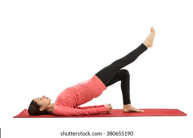 Woman doing bridge pose with leg extension