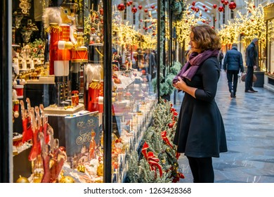 Woman doing Christmas shopping in luxury arcade, London