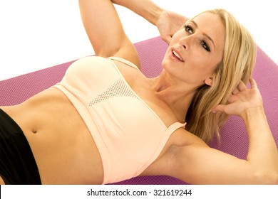 a woman doing a crunch in her fitness clothing.