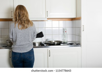 Woman doing the dishes at home
