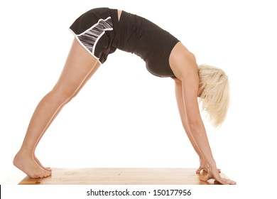 a woman doing downward dog stretch from yoga