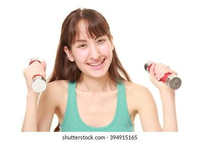 woman doing dumbbll exercise