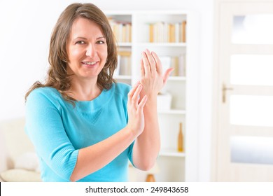 Woman doing EFT on the karate chop point. Emotional Freedom Techniques, tapping, a form of counseling intervention that draws on various theories of alternative medicine.
