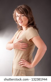 Woman doing EFT on under arm point. Emotional Freedom Techniques, tapping, a form of counseling intervention that draws on various theories of alternative medicine.