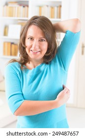 Woman doing EFT on the under arm point. Emotional Freedom Techniques, tapping, a form of counseling intervention that draws on various theories of alternative medicine.