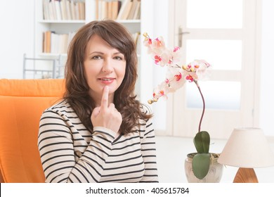 Woman doing EFT on the under lip point. Emotional Freedom Techniques, tapping, a form of counseling intervention that draws on various theories of alternative medicine.