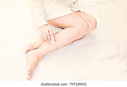 Woman doing epilation
