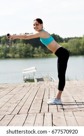 Woman doing excercise in nature.