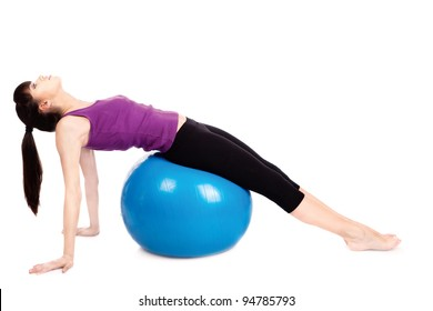Woman doing exercise with pilates blue ball, isolated on white