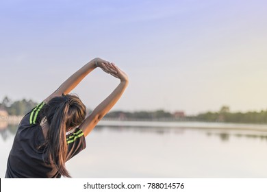 woman doing exercises and warm up before run and Physical fitness test ; Healthy lifestyle cardio together at outdoors