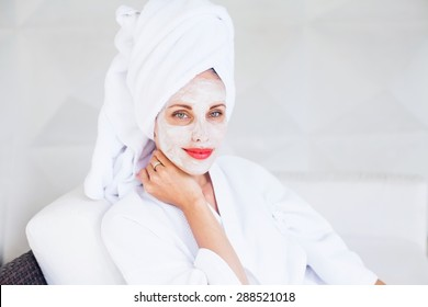 woman doing face mask at home