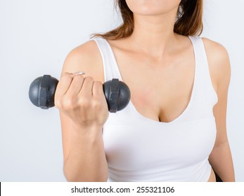 Woman doing fitness exercise with a hand weights.