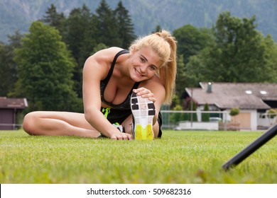 Woman doing fitness exercise push up outdoor