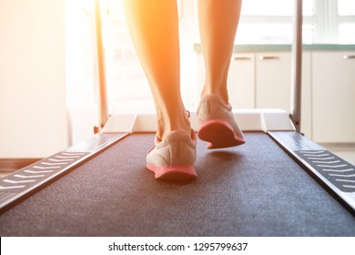 Woman doing fitness on a treadmill