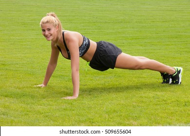 Woman doing fitness stretch exercise outdoor