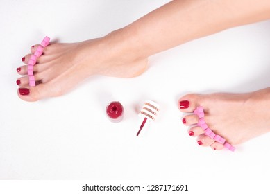 Woman doing foot care and nail treatment .