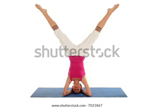 Woman Doing A Headstand On A Yoga Mat