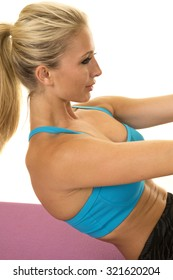 A woman doing her exercise looking to work her abs.