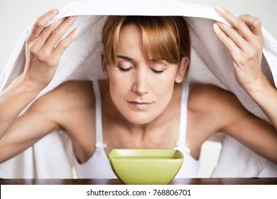 woman doing inhalations over a bowl