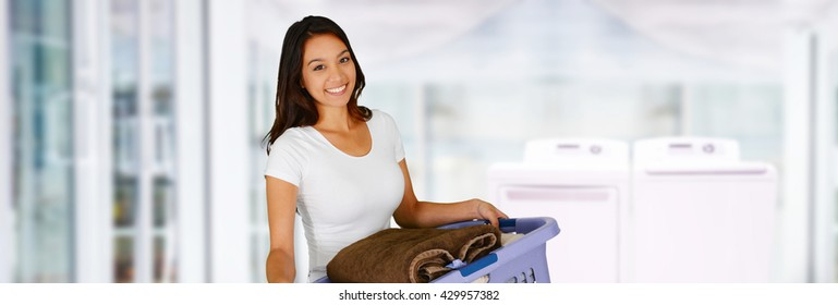 Woman doing laundry in her new home