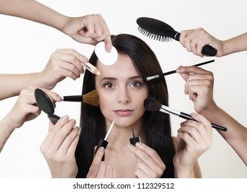 woman doing make up with many hands and arms helping her get the job done faster