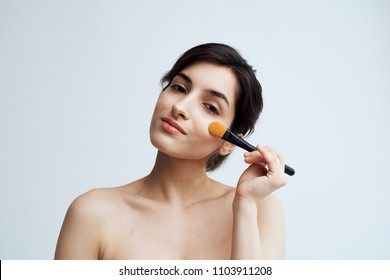 woman doing make-up, brushes