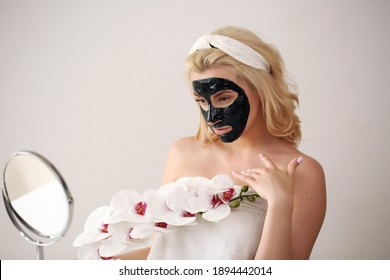 woman doing morning skin care after shower.