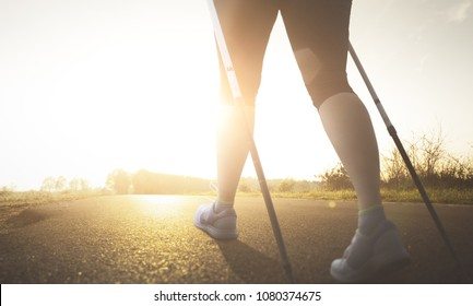 Woman doing nordic walking