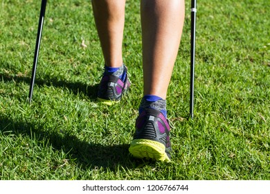 A woman doing nordic walking in the park
