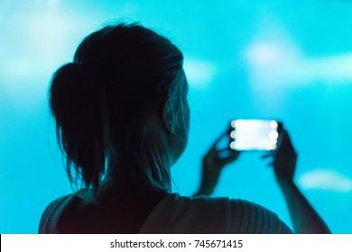 Woman doing photos in the aquarium.