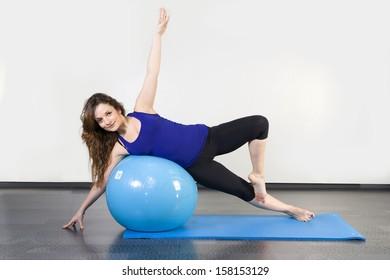 woman doing pilates ball on the floor