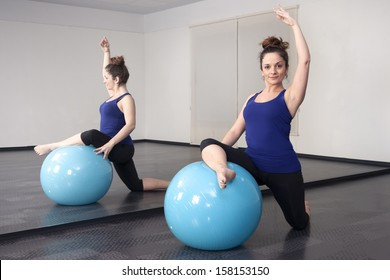 woman doing pilates ball on the floor in the mirror