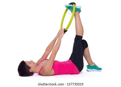 Woman doing pilates ring workout