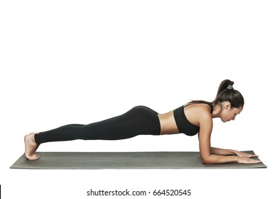 Woman doing plank. Young attractive brunette with fit body working out in yoga class. Healthy lifestyle concept. Isolated on white.