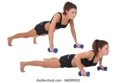 woman doing push-ups on dumbbells