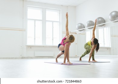 Woman doing revolved triangle yoga pose