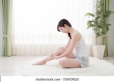 Woman doing self massage, Calves, foot