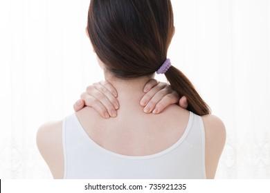 Woman doing self massage, neck, shoulder