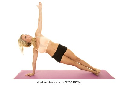 a woman doing a side plank on her fitness mat.