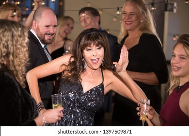 Woman doing a silly dance at a party or reception