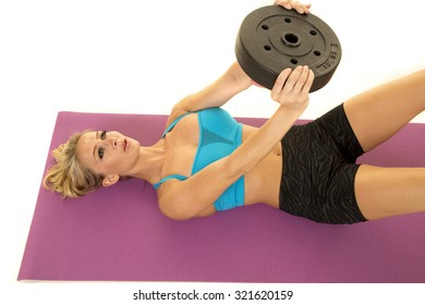 a woman doing some ab crunches with a weight.