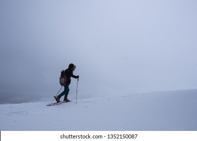 Woman doing sports, advances in the mountains in the middle of a great snow, Irati, Pyrenees, Navarra