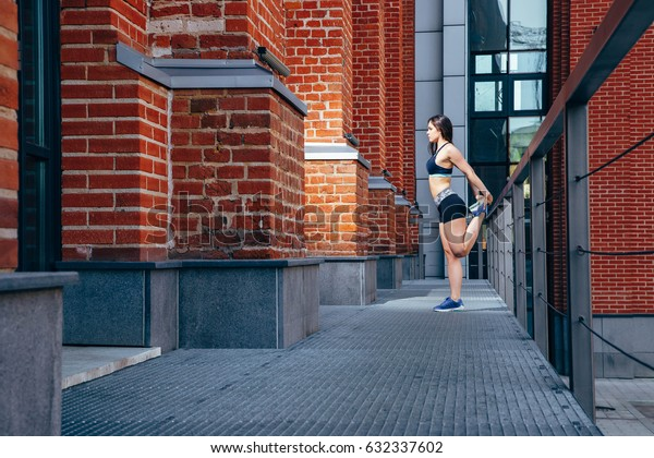 Woman doing sports exercises outdoors