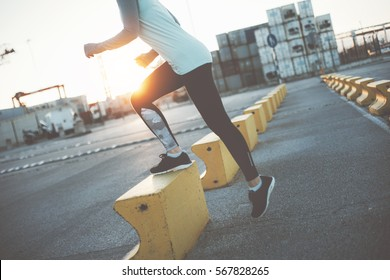 Woman doing step-up. Urban workout. Warming sport exercise