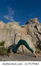 Woman doing stretching for yoga in the mountain