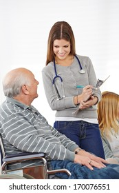 Woman doing survey with senior man for quality management in nursing home