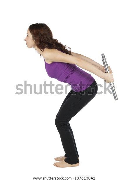 Woman doing triceps kickback during workout with dumbbells.