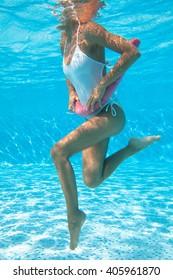woman doing water aerobics