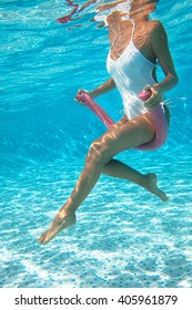 woman doing water aerobics in a swimming pool