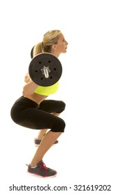 A woman doing a weighted squat with the bar on her back